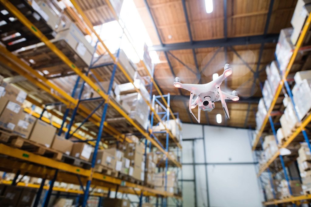Drones inspecting a warehouse
