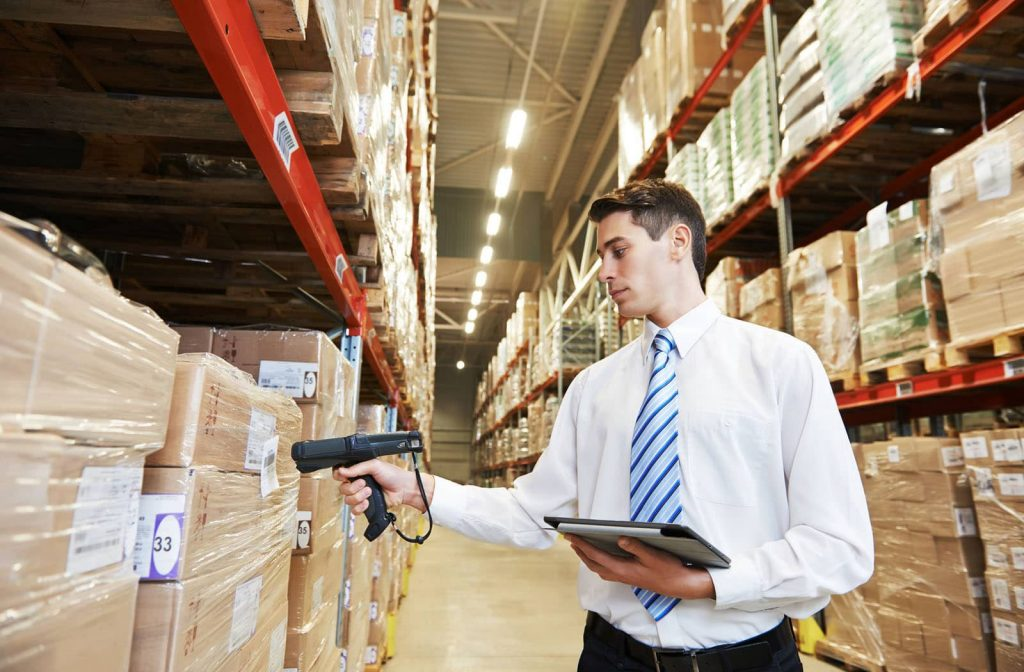 Man inspecting stocks in a warehouse