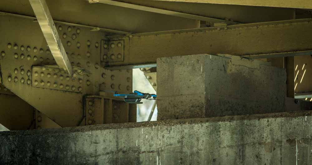 Drone inspecting inner section of a bridge